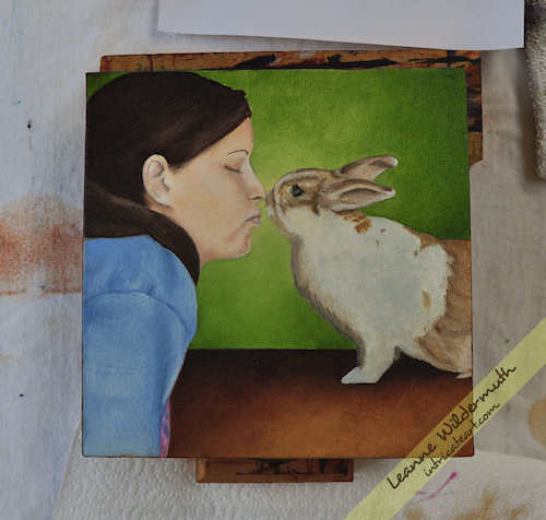 A girl and her bunny portrait kisses love painting progress by Leanne Wildermuth